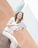 Young casual business woman using tablet on a break Royalty Free Stock Image