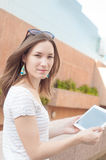Young casual business woman using tablet on a break Stock Photo
