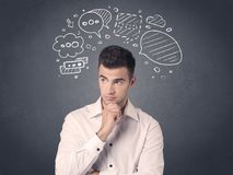 Businessman with speech bubbles. Young casual businessman with drawn speech bubbles over his head Stock Photo