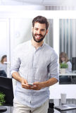 Young casual businessman with phone Stock Images