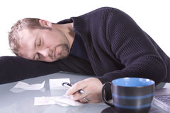 Young Casual Businessman Sleeping at his Desk Royalty Free Stock Photo