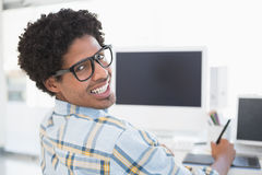 Young casual businessman smiling at camera Stock Images