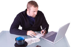 Young Casual Businessman Working at his Desk Stock Images