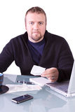 Young Casual Businessman Working at his Desk Royalty Free Stock Image