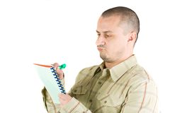 Young casual businessman writing. In a notebook Stock Image