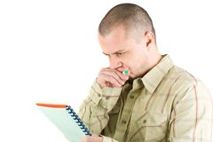 Young casual businessman writing. In a notebook Royalty Free Stock Photography