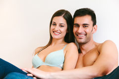 Young Casual Couple in Bed Stock Images