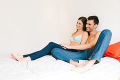 Young Casual Couple in Bed Royalty Free Stock Image