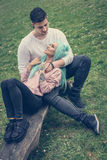Young casual couple enjoying in the park. Royalty Free Stock Image