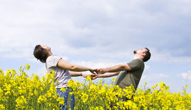Young casual couple enjoying summer. Field Royalty Free Stock Photos