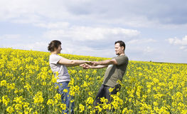 Young casual couple enjoying summer. Field Royalty Free Stock Images