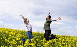 Young casual couple enjoying summer. Field Royalty Free Stock Photo