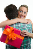 Young casual couple with gift Stock Photo