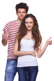 Young casual couple giving thumbs up Royalty Free Stock Image