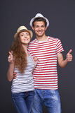 Young casual couple giving thumbs up Stock Photography