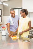 Young casual couple making fruits Royalty Free Stock Photography