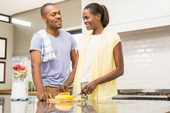 Young casual couple making fruits Stock Photos