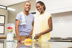 Young casual couple making fruits Royalty Free Stock Photo