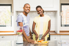 Young casual couple making fruits Royalty Free Stock Images