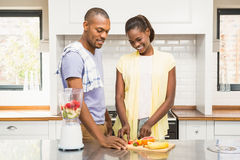 Young casual couple making fruits Stock Image
