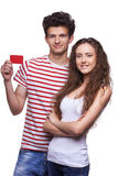 Young casual couple showing credit card Stock Photo