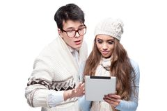 Young casual couple using tablet Stock Photo