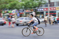 Young casual dressed commuter on a bicycle, Beijing, China royalty free stock image