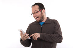 Young casual dressed man texting on his phone Royalty Free Stock Images