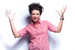 Young casual excited woman screaming. On white background Royalty Free Stock Photo