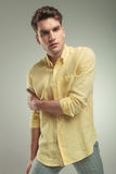Young casual fashion man holding his right arm Royalty Free Stock Photo
