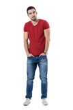 Young casual fashion model with hands in pockets looking away Stock Images