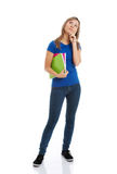 Young casual female student with workbook is thinking. Stock Photos