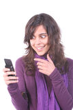 Young Casual Girl, surprised. Looking at her cellphone, isolated on white background royalty free stock photography