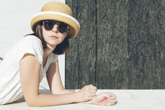 Young casual girl wearing a hat and sunglasses Royalty Free Stock Image