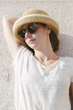 Young casual girl wearing a hat and sunglasses relaxed Stock Image