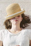 Young casual girl wearing a hat and sunglasses relaxed Stock Images