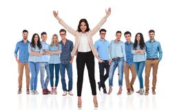 Young casual group with their businesswoman leader celebrating i. Young casual group with their excited businesswoman leader celebrating with both hands in the royalty free stock images