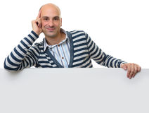 Young casual guy with blank poster Stock Photos
