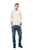 Young casual handsome man wearing jeans and sneakers with hands in pockets Royalty Free Stock Photos