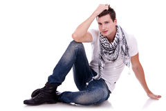 Young casual happy man seated Royalty Free Stock Photography
