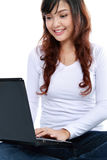 Young casual holding laptop Stock Photography