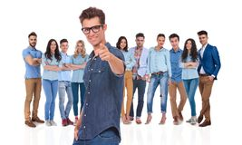 Young casual leader with glasses wants you in his team. Young casual leader with glasses wants you to be in his team, pointing finger while standing on white stock photo