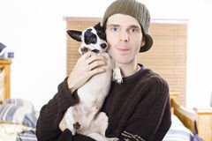 Young casual lifestyle man with small dog Royalty Free Stock Image