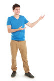 Young casual male presenting something Royalty Free Stock Photography