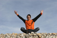 Young casual man with arms wide. Open at the beach royalty free stock photos
