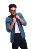 Young casual man arranging his collar Royalty Free Stock Photography