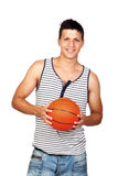 Young Casual Man with a Basketball Ball Royalty Free Stock Image