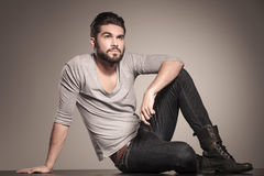 Young casual man with beard looks up Stock Photo
