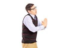 Young casual man begging Stock Photos