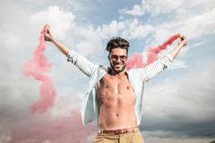 Young casual man celebrating freedom outside Royalty Free Stock Photos
